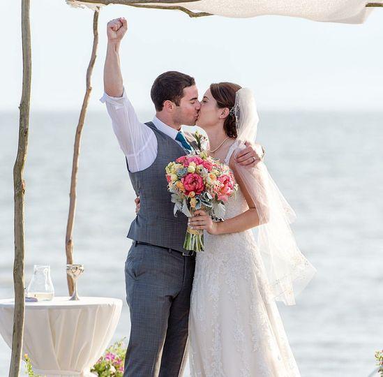 Couple kissing and celebrating
