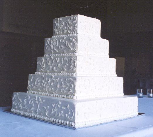 Five-tiered square cake with buttercream icing