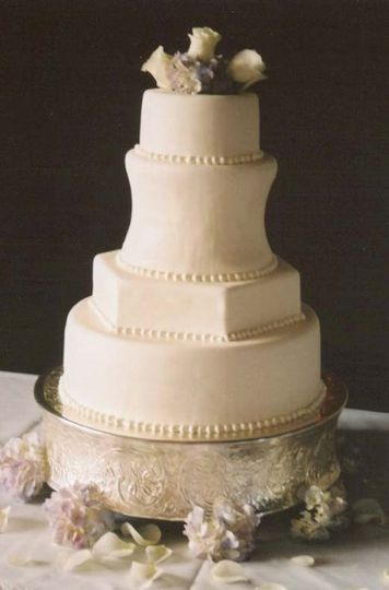 A combination of square and round tiers iced in Italian meringue buttercream.  We have done many...