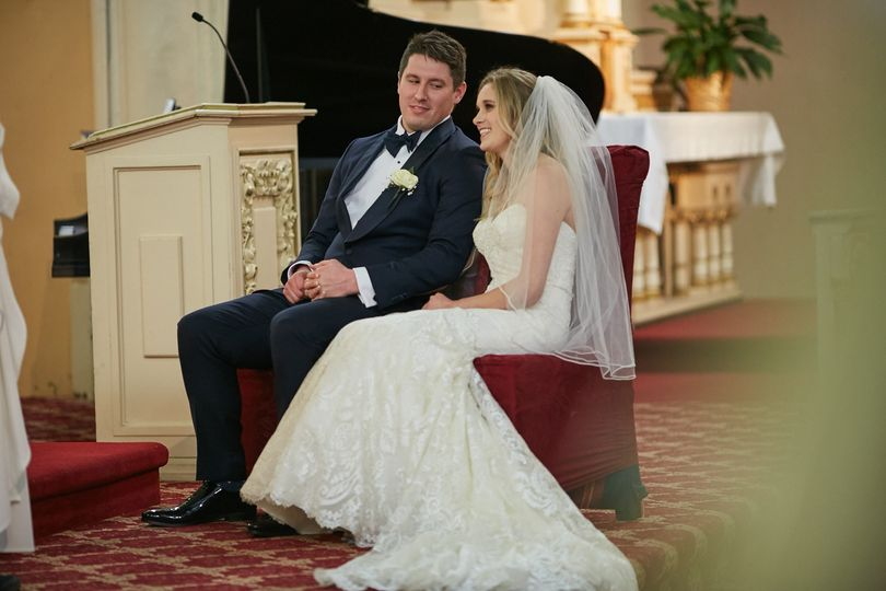 Bride and groom waiting in church