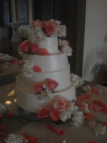 swiss buttercream covered cake, with a cascade of fresh flowers