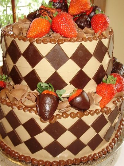 2 tiered chocolate buttercream cake with chocolate diamonds, chocolate shavings and dipped...