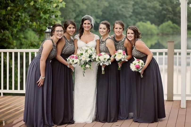 Gorgeous bride with her bridesmaids. Updo & Makeup Application