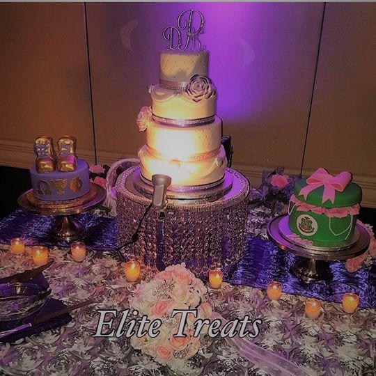 Stunning wedding cake with purple ribbons