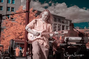 Eric Hutchins on guitar