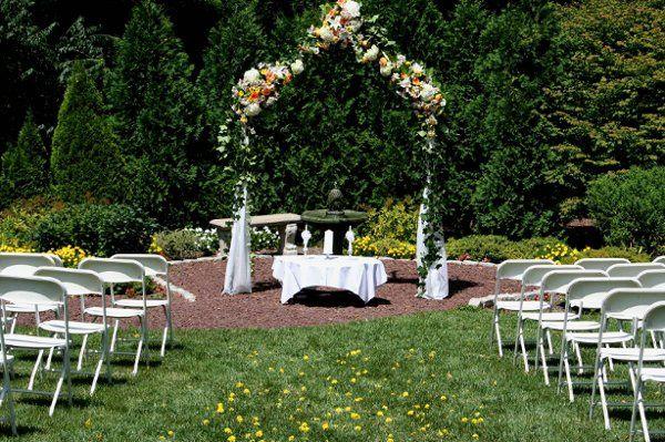 Floral arch decor and altar setup