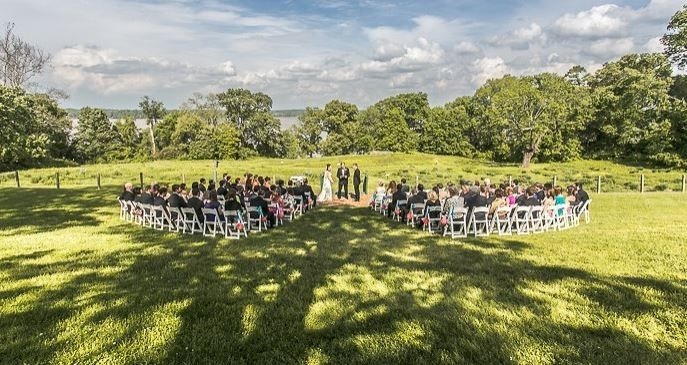 One area to get married in overlooks our meadow and the Potomac River ....