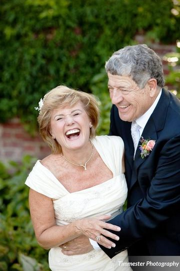 Bride and groom sharing laughs