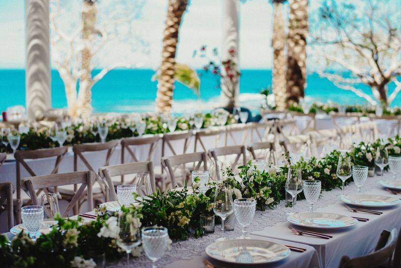 White-themed wedding reception at Chileno Bay.Photography Credit: Fer Juaristi