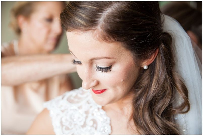 Bride getting dressed | Macon Photography