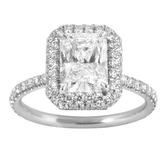 This Burdeen's custom, elegant filigree engagement ring constists of a radiant-cut diamond with a...