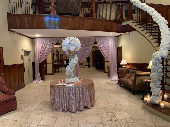 Tmx Atrium Floral Staircase And Sign In Table With Drape No One In Picture 51 2233 1560969585 Tyrone, GA wedding venue