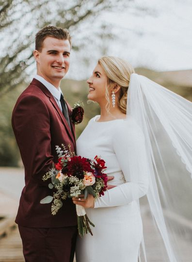 Groom and bride with wedding flowers