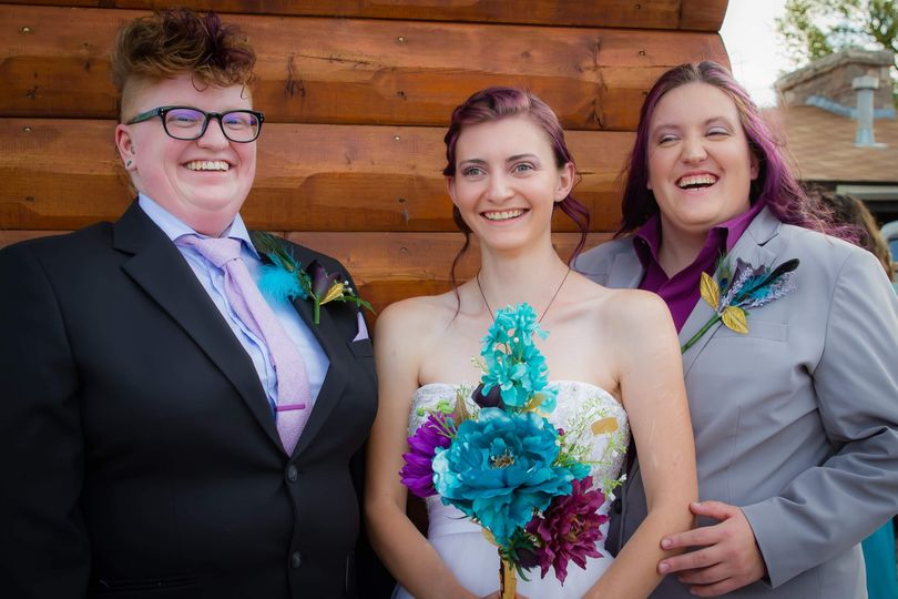 Karter with two happy brides