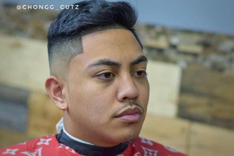 Comb over mid fade