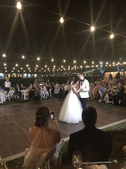 Romantic first dance under hanging lights