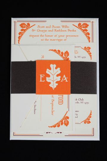 White, orange, and black wedding invite