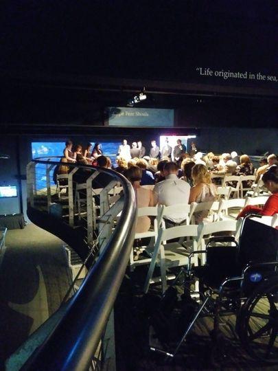 ceremony set up at aquarium and rehearsal prior
