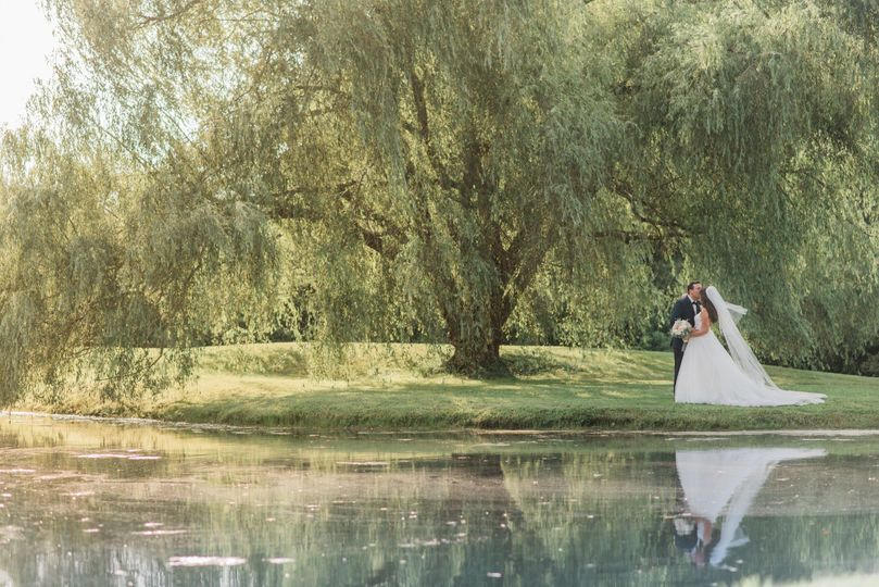 Bride and Groom by Pond
