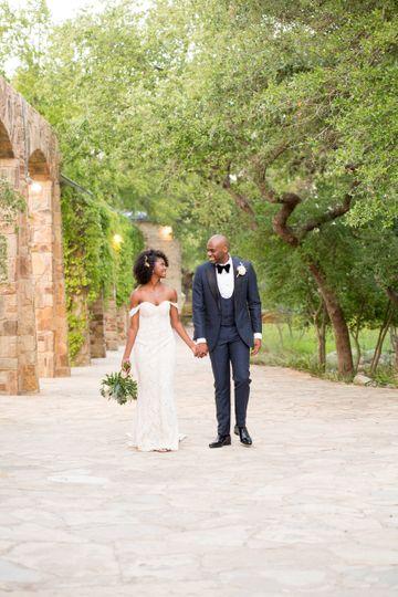 Newlyweds walking hand-in-hand