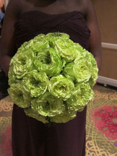 purple bridesmaid with green rose bouquet