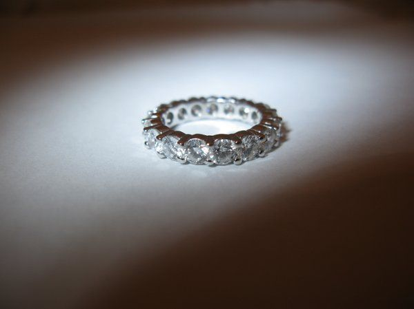 All eyes will be on your ring! Custom made diamond eternity band using customers own stones. Shown...