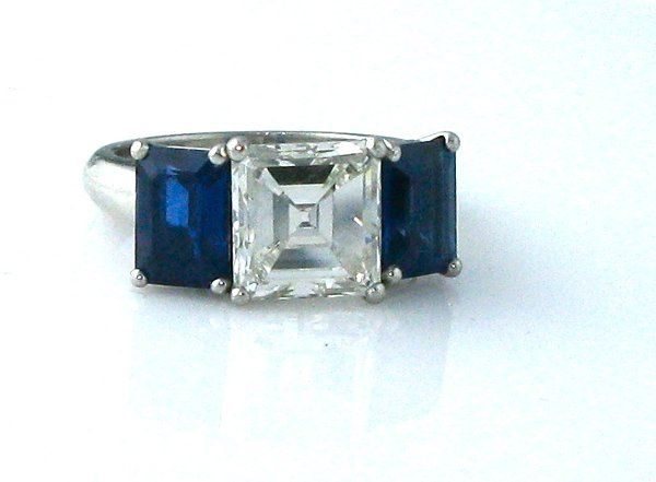 Flank a center diamond with color! Hand made setting. Can be made with any size/shape stones. This...
