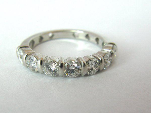 7 Stone Diamond Wedding Band. 18K white gold semi eternity band with seven brilliant round diamonds....