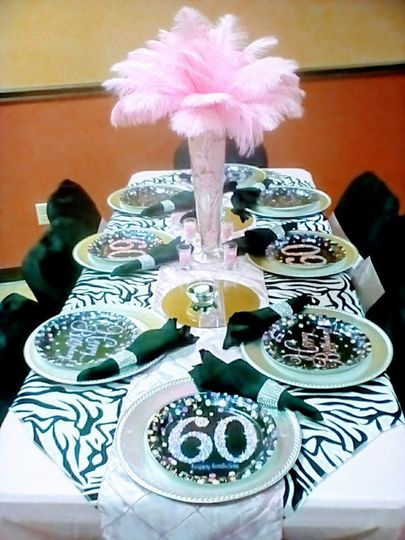 Celebrating 60th Birthday Party. Pink ostrich feather centerpiece.