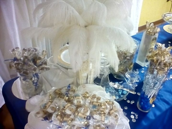 Gourmet Candy Buffet with White ostrich feathers decorating the table.