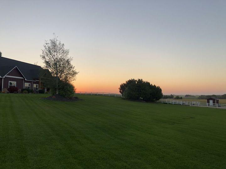 Sun setting across the horizon