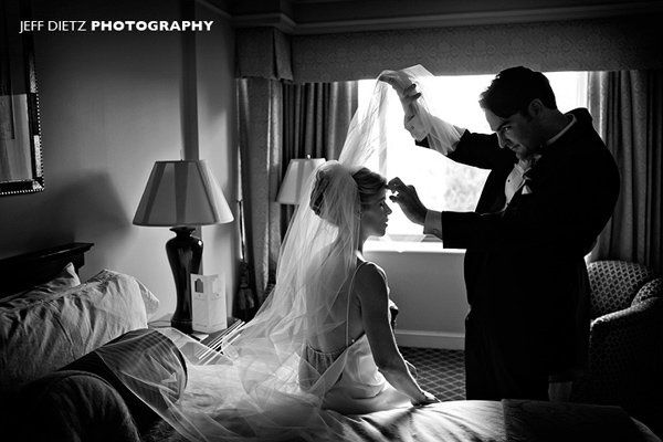 This is a natural moment of the bride getting ready in the Rittenhouse Square hotel in Philadelphia,...