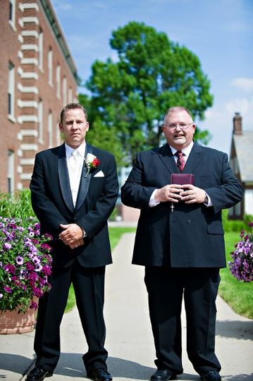 The officiant and the groom