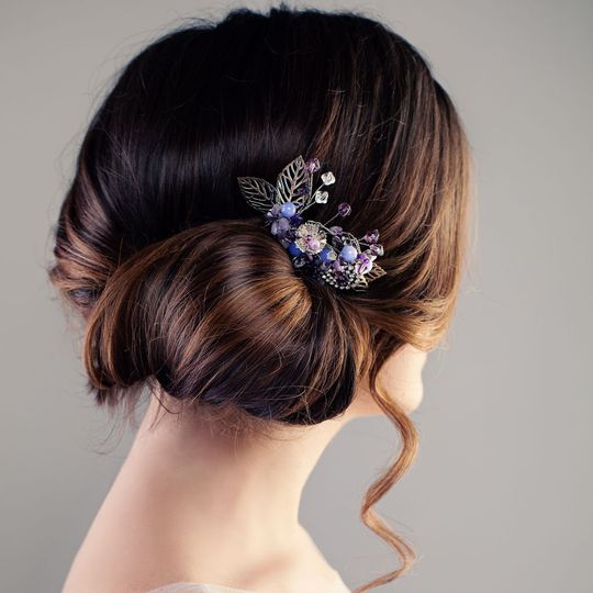 Neat low bun pinned with elegant broach