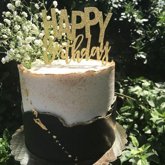 Custom birthday cake with fresh flowers