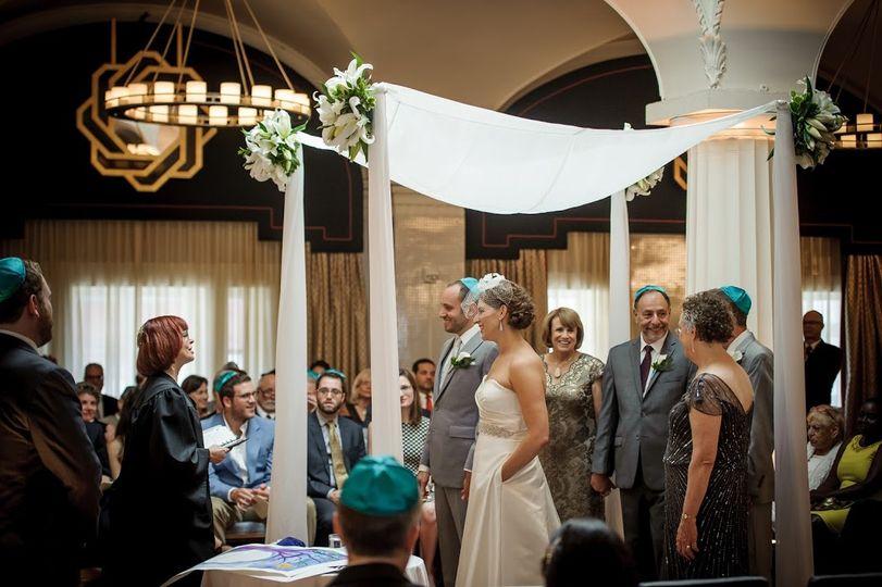 Rabbi Marcey singing to couple