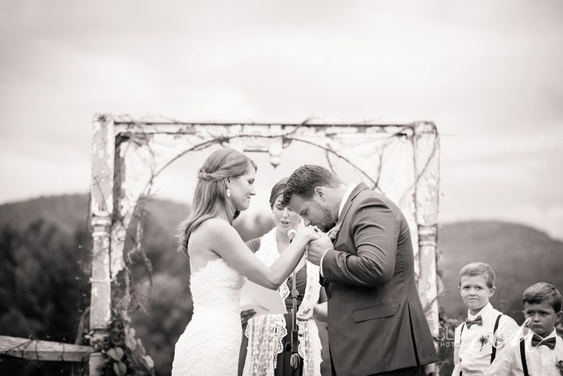 This is a tender moment, capturing the Groom's love by kissing Bride's hand before wedding ceremony...