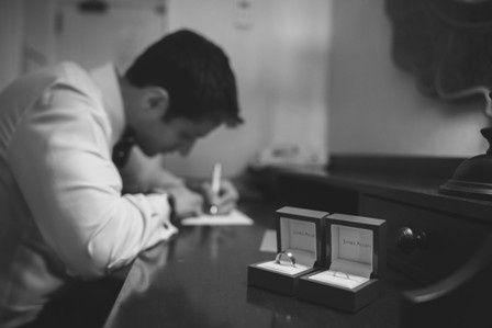 Groom writing love letter