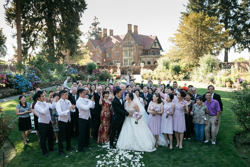 Photographer Jenny GG captures a moment with ALL of Clara & James's wedding guest in front of...