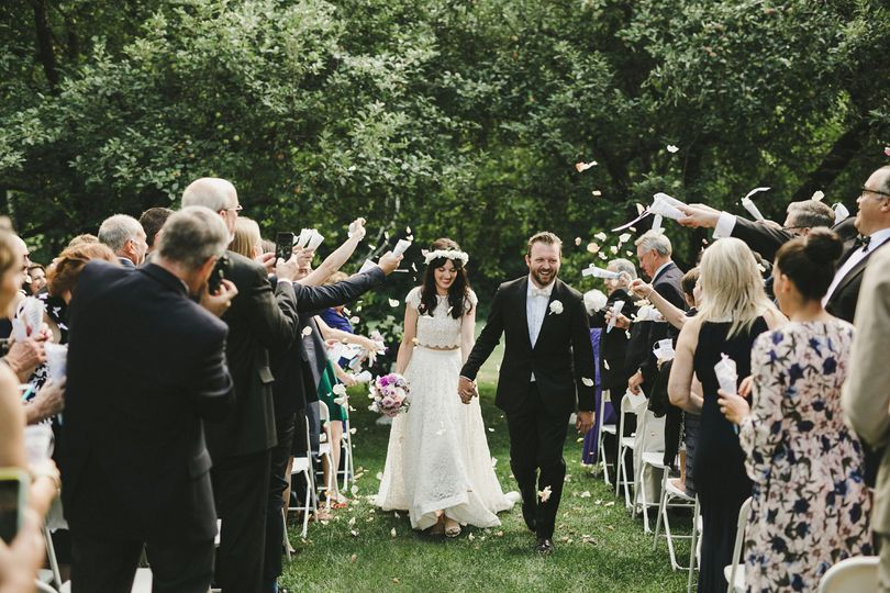 Cones of flower petals  were tossed as newly weds walked down the aisle.Shari + Mike...