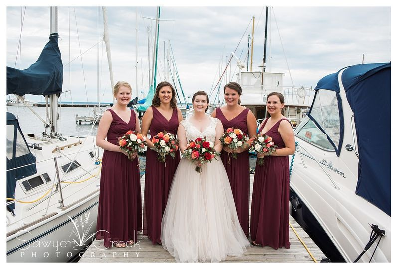 The wedding party on the dock