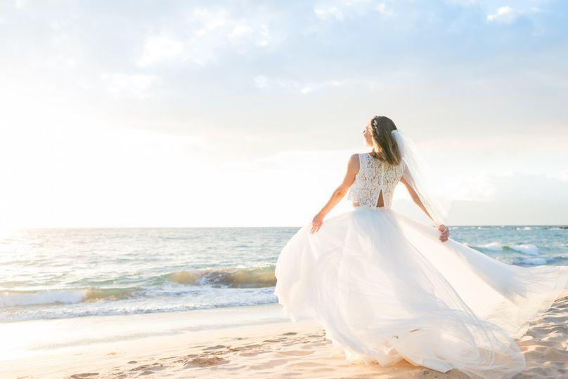 Beautiful bride on the beach taken by Maui wedding photographers Karma Hill Photography.