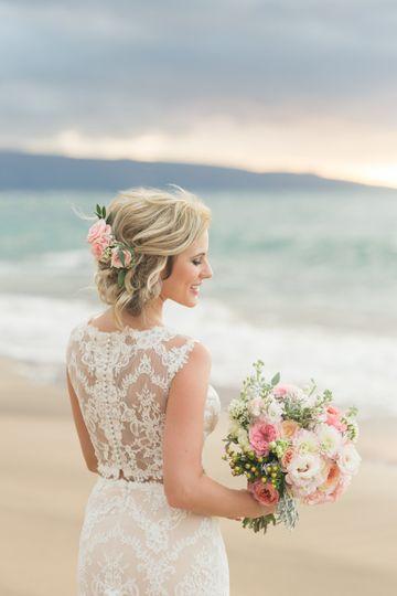 Beautiful up-do photo by Karma Hill Photography in Maui, Hawaii.
