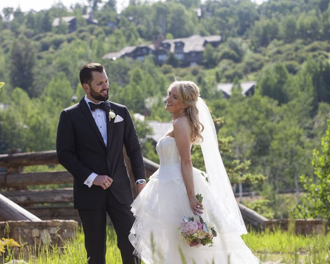 A happy bride & groom celebrating at the Ritz Carleton in Beaver Creek, CO.