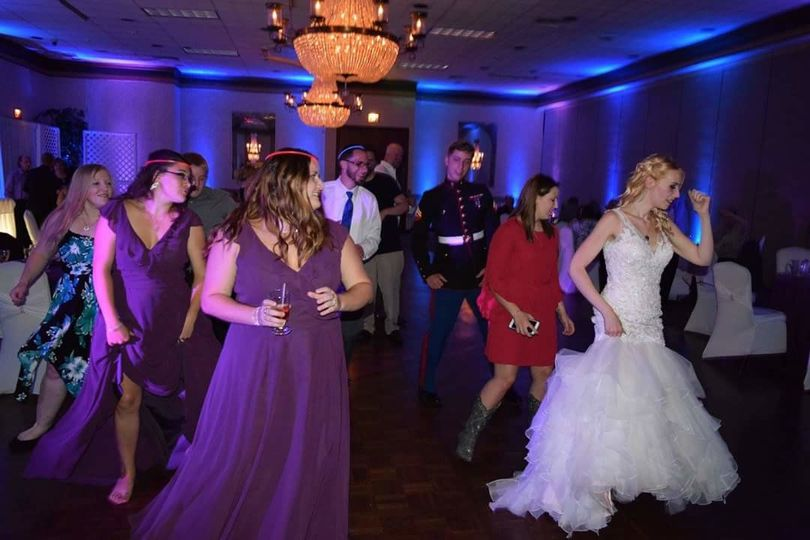 Bride on the dance floor with guests