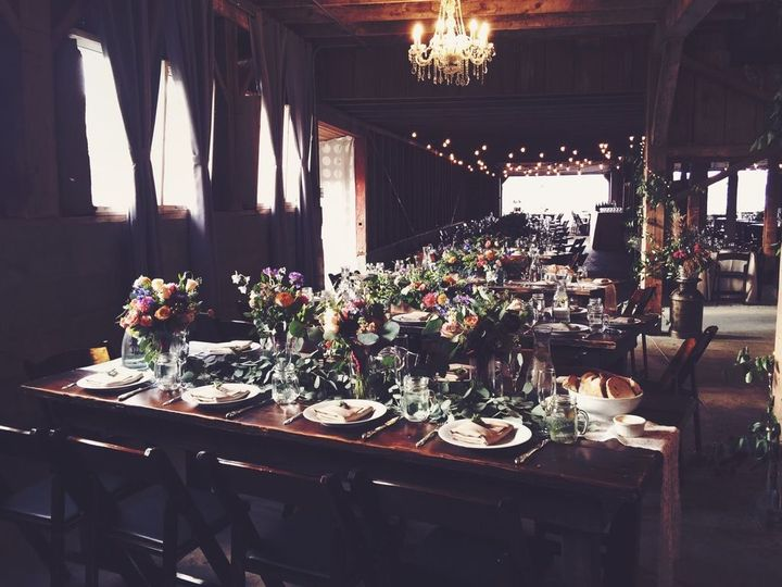The inside of the barn, all dressed up for a wedding! Beautiful rented tables brought in for an...