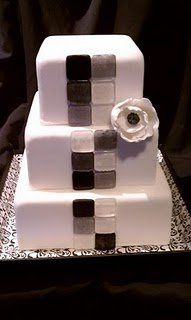 A modern wedding square wedding cake with poured sugar glass tiles creating a striking pattern on...