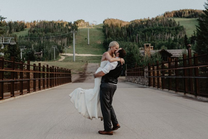 We snuck away from dinner for a few fun bride and groom photos at sunset around the village in Vail...