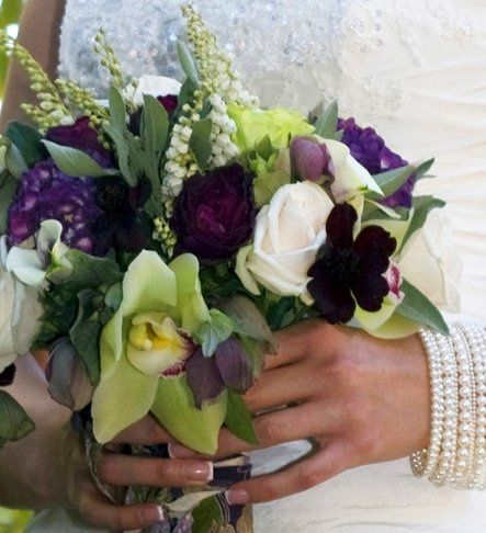 This bouquet is filled with deep rich tones of plum and soft creamy whites with accents of brown and...