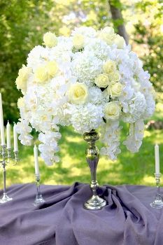 White and yellow flowers for table centerpiece